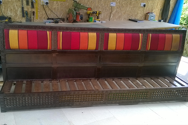 An image of a newly refurbished bench for a restaurant, with draw wood and inbuilt cushions